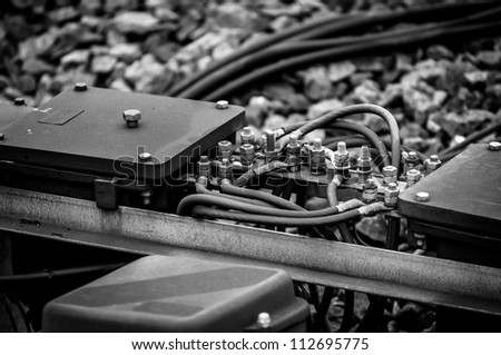 Closeup photo of a railway part with wires