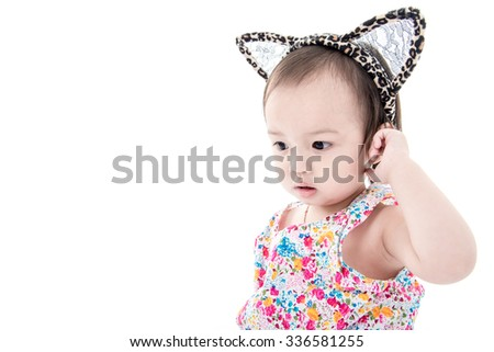 Closeup photo of beautiful cute asian baby's expression on white. - stock photo