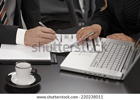 Closeup photo of businesspeople discussing business report. - stock photo