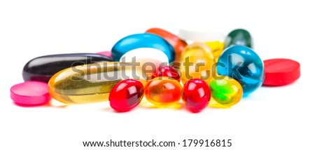 Closeup photo of colorful pills on white isolated background