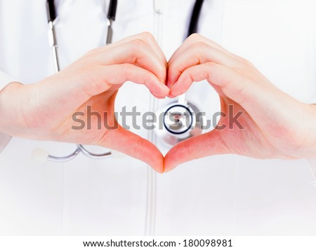 Closeup photo of doctor hands shaping a heart - stock photo