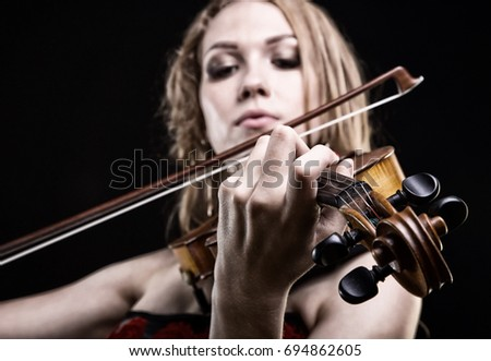 Closeup photo of girl playing the violin