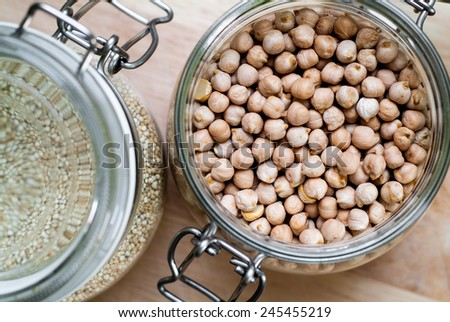 closeup photo of glass jars with chickpeas and quinoa - stock photo