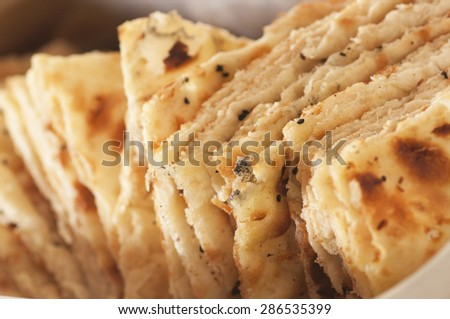 Closeup photo of indian bread with cumin. - stock photo