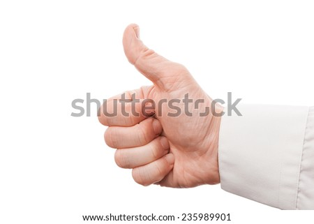 Closeup photo of male hand showing thumbs up sign isolated on white background - stock photo