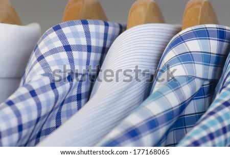Closeup photo of Mens's dress shirts hanging. - stock photo