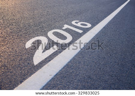 Closeup photo of New Year 2016 Ahead concept on the road.