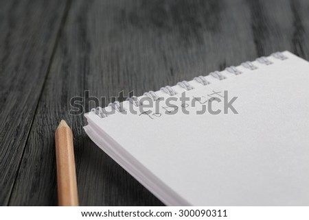 closeup photo of open empty notepad with to do list phrase, on wood table - stock photo