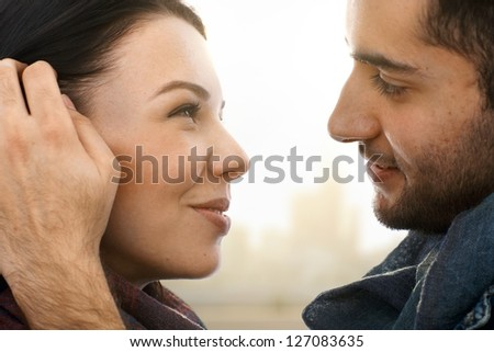 Closeup photo of romantic kissing couple, side view. - stock photo