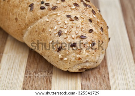 Closeup Photo Of Rye Roll Mixed From Many Different Healthy Ingredients Like Pieces Of Soy