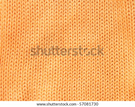 Closeup photo of the orange woolen clothe