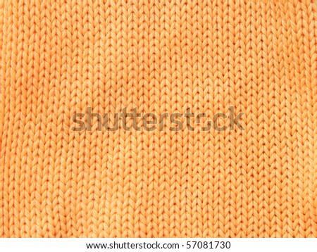 Closeup photo of the orange woolen clothe - stock photo