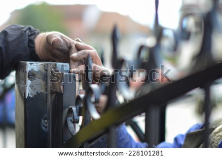 Closeup photo of tho workers  building metal wrench  - stock photo