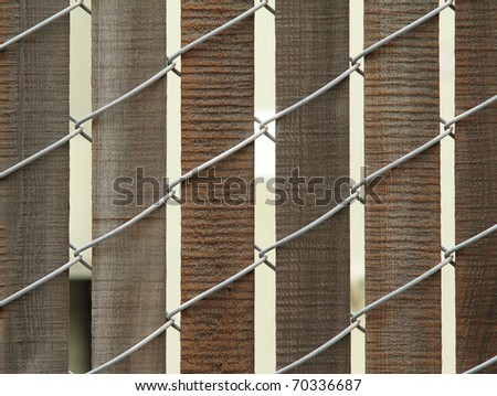 Closeup photo of wooden fence with wire - stock photo