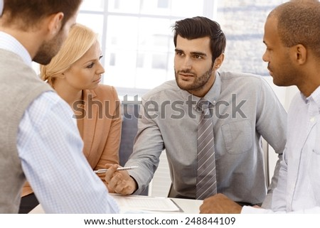 Closeup photo of young businesspeople working together in team. - stock photo