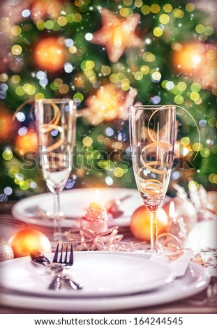 Closeup photo on festive dinner still life, festive table setting on luxury decorated Christmas tree background, New Year eve concept - stock photo