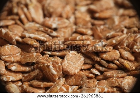 Closeup photograph of oat flakes, rolled grains. Healthy lifestyles and nutrition - stock photo