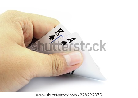 Closeup photos that focuses on the black jack with King card and ace card of spade in the hand on white background - stock photo