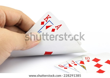 Closeup photos that focuses on the King card and ace card of diamond of poker game in the hand on white background - stock photo