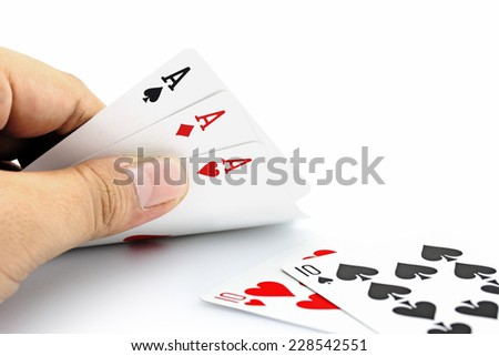 Closeup photos that focuses on three card of ace in hand,in poker game on white background - stock photo