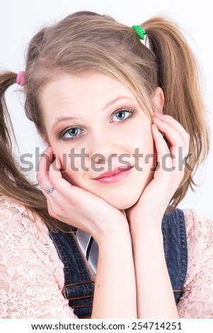 Closeup picture of a beautiful young woman day-dreaming - stock photo