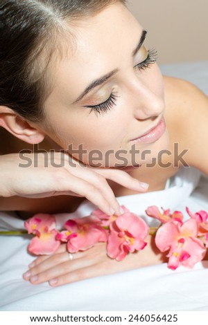 Closeup picture of charming brunette lady takes a relaxing beauty spa treatments - stock photo