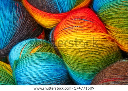Closeup picture of colorful balls of wool - stock photo