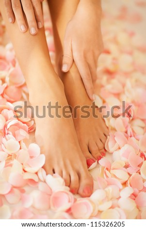 closeup picture of female hands and legs - stock photo