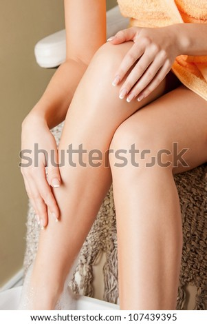 closeup picture of female hands and legs in spa salon - stock photo