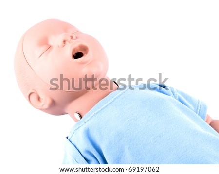 Closeup picture of first aid traning infant dummy on white background - stock photo