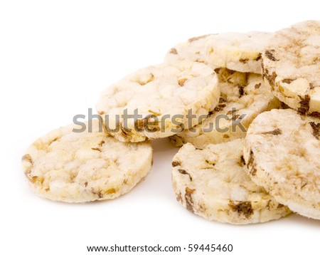 Closeup picture of small rice cakes on white background - stock photo
