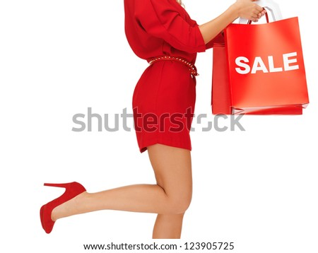 closeup picture of woman on high heels holding shopping bags - stock photo