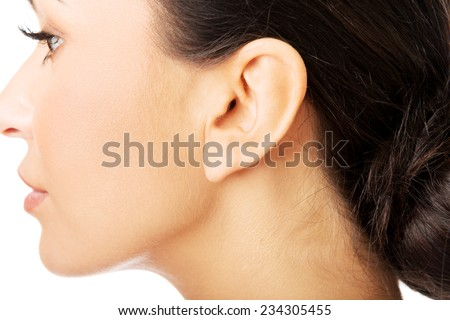Closeup picture of woman's ear. - stock photo