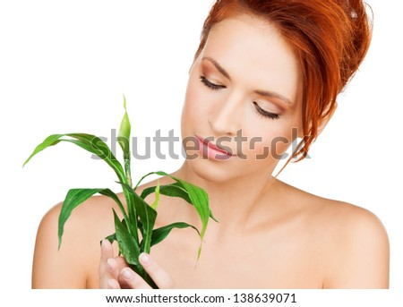 closeup picture of woman with green sprout - stock photo