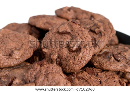 closeup pile of double chocolate chip cookies over white - stock photo