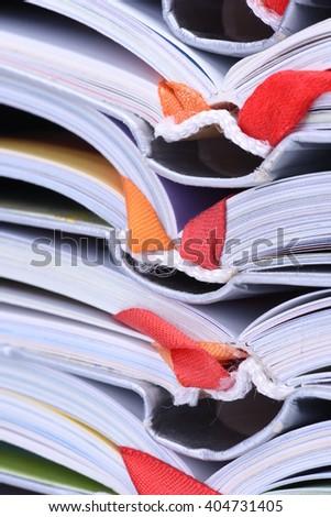 Closeup pile of open books - stock photo