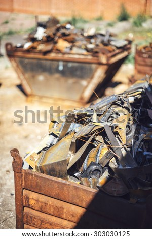 Closeup pile of scrap metal junk garbage - stock photo