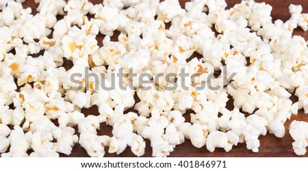 Closeup pile of white fluffy popcorn lying mixed together