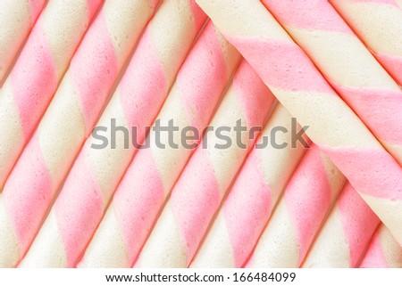 Closeup pink stripe wafer rolls Background . - stock photo