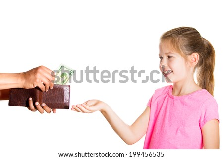 Closeup portrait adorable little girl demanding, asking money for allowance, guy pulls out money, cash, dollar bills from wallet to give her, isolated white background. Family budget concept - stock photo