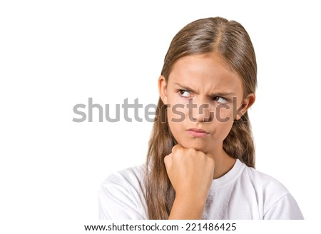Closeup portrait angry grumpy teenager girl displeased jealous looking to side isolated white background copy space. Negative human emotions facial expression feeling attitude reaction body language - stock photo