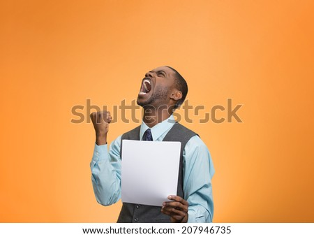 Closeup portrait angry, mad, screaming business man holding paper, document, screaming, looking up isolated orange background. Negative emotions, facial expression, feeling. Financial crisis, bad news - stock photo