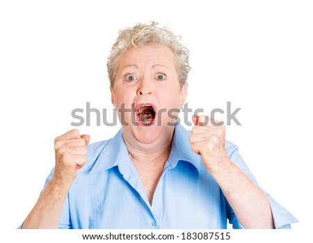 Closeup portrait angry, upset senior mature, woman, worker, employee, business lady, fists in air, open mouth yelling isolated white background. Negative emotions, facial expression reaction - stock photo