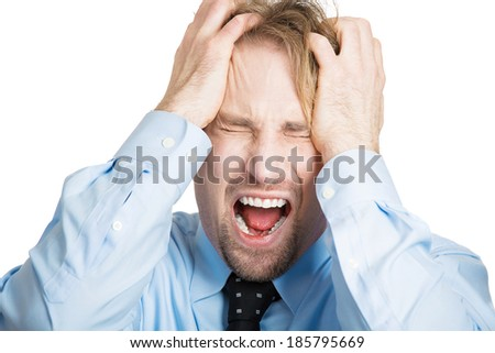 Closeup portrait angry, upset, young man, worker, mad employee, funny looking business man, hands on head, open mouth yelling, isolated white background. Negative emotions, facial expression, reaction - stock photo