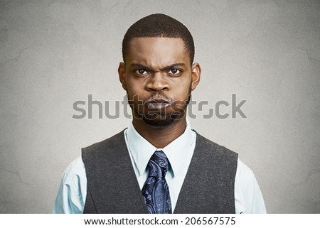 Closeup portrait angry young business man, blowing steam, about to have nervous atomic breakdown, isolated black background. Negative human emotions, facial expressions, reaction, feelings attitude - stock photo