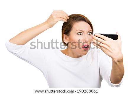 Closeup portrait, annoyed woman looking worried at white color hair or balding, isolated white background. Negative human emotion facial expression feelings, attitudes, reaction, situation - stock photo