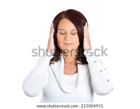 Closeup portrait attractive, peaceful, relaxed looking, middle aged woman covering ears, closing her eyes, isolated white background. Hear no evil concept. Human emotions, facial expression, attitude - stock photo