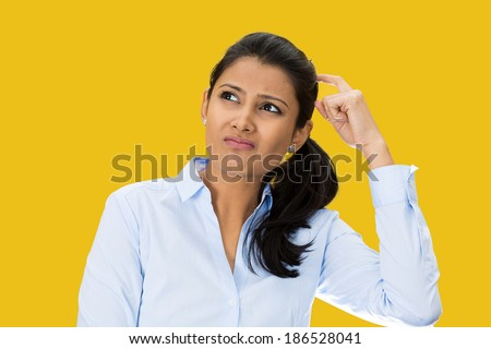 Closeup portrait, beautiful, pretty young woman thinking daydreaming trying to remember something, scratching head looking upwards, isolated yellow  background. Human facial expressions signs symbols - stock photo
