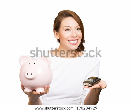 Closeup portrait, beautiful, young woman, dealership agent holding model black car, pink piggy bank in hand, offering credit line, isolated white background. Lease, automobile purchase, financing.