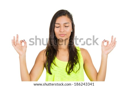 Closeup portrait, beautiful, young woman relaxing, meditating, in zen mode, isolated white background. Positive emotions, facial expressions, attitude, perception of life, situation, signs symbol - stock photo